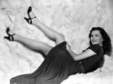 Faith Domergue Laid Down in Black Dress and Black Sandals