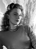 Joan Leslie on Long Sleeve Top posed and Leaning