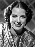 Eleanor Powell on a Shining Top and smiling