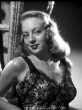 Evelyn Keyes on an Embroidered Top and smiling