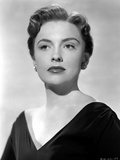 Joan Leslie Showing a Serious Face  wearing a Black V-Neck Dress in Portrait