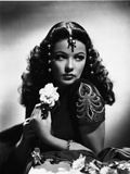 Gene Tierney Holding a Flower in Black and White