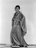 Kay Francis on a Silk Dress with Hands on Waist