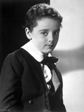 Freddie Bartholomew sitting on Chair With Leg's Cross