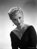 Judy Holliday wearing a V-Neck Dress and Earrings in a Portrait
