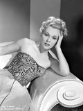 Eva Gabor on a Embroidered Top sitting on a Couch