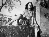 Hedy Lamarr sitting on a Printed Vcloth in Midriff Top