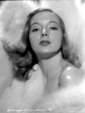 Evelyn Keyes Surrounded with Furr and posed