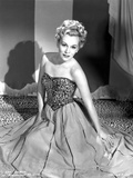 Eva Gabor on a Embroidered Top sitting on the Floor
