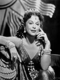 Hedy Lamarr sitting in a Silk Dress