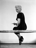 Judy Holliday sitting with Legs-Crossed