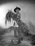 Eva Gabor on a Dress Carrying Dried Leaves and Twigs