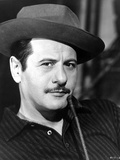 Eli Wallach Posed in Black Suit With Hat
