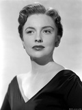 Joan Leslie wearing a Black V-Neck Dress with Earrings in Portrait