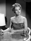 Eva Gabor on a Embroidered Top sitting on the Chair