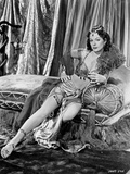 Hedy Lamarr sitting on a Couch in Egyptian Attire