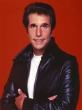 Henry Winkler in a Leather Jacket in a Red Background