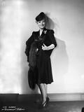 Eva Gabor on Dark Dress Leaning on Wall Portrait