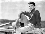 Frankie Avalon sitting on Wood With Holding Hat