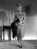 Gloria DeHaven Posed Siting on Black Gown