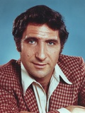 Judd Hirsch wearing a Red Checkered Suit in a Close Up Portrait