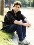 John Cusack sitting on the Side Walk