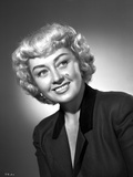 Joan Blondell on a Leaning and smiling Portrait
