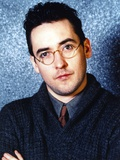 John Cusack wearing a Sweater and Glasses