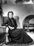 Martha Hyer on Dark Long Sleeve Gown and sitting