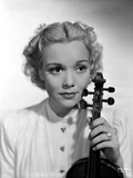 Jane Wyman Portrait in White Long Sleeve Shirt with Hand Holding a Violin