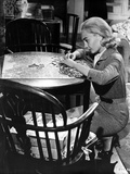 Jean Simmons squatting In front of the Table while Playing a Puzzle in Grey Tweed Suit Dress and Gr