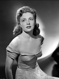 Joan Leslie on an Off Shoulder Silk Dress sitting and posed