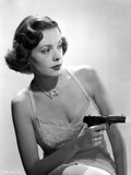 Jane Greer on a Lace Top Holding a Gun