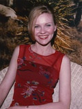 Kirsten Dunst smiling in Red Dress