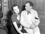 John Barrymore Seated with Woman