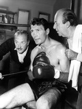 Jack Palance sitting in Chair With Boxing Gloves