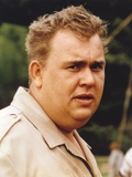 John Candy wearing Gray Coat