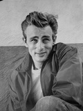 James Dean Portrait in Black Jacket and Heat Turn to the Left with Left Arm Rest on the Right Leg