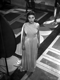 Jean Simmons Posed in White Single-Shoulder Draped Dress with Hands on the Side