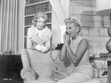 Imitation Of Life Lady in Pearl Necklace Talking on Phone with a Child