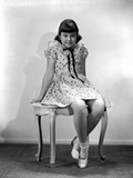 Jane Withers Seated on a Chair in White Polka Dot Short Sleeve Blouse with Hands Rest on the Side a