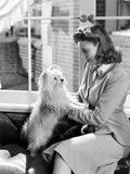 Joan Leslie on a Blazer and Holding a Dog