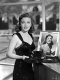 Joan Leslie on a Dress With Her Own Portrait in a Frame