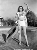 Jane Withers Posed in White V-Neck Short Sleeve Shirt and Flip Skirt with Striped Long Sleeve Colla