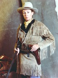 Jane Alexander Posed in Brown Velvet Fringe Coat and Black Belt with Cowboy Hat