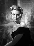 Jean Simmons Seated in Black Velvet Off-Shoulder Dress and Necklace with Dangling Earrings