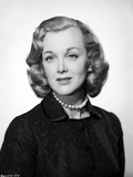 Jan Sterling Portrait in Black Velvet Dress and Pearl Necklace in White Background