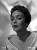 Jane Wyman Portrait in White Long Sleeve Shoulder Dress and Pearl Necklace with Pearl Earrings