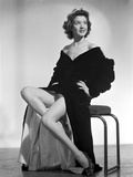Jane Withers Seated on a Chair in Black V-Neck Ruffled Sleeve Dress with Sheer Petticoat