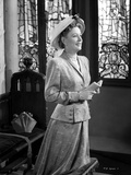 Irene Dunne on Blazer and Hat Kneeling